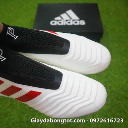 """Các vân nổi kiểm soát bóng của Adidas Predator 19+ cùng với logo """"Paul Pogba"""" in trên cổ giày"""