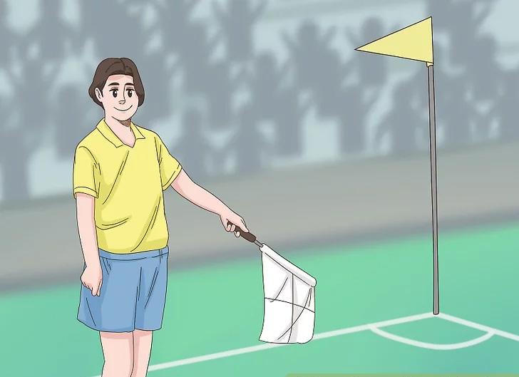Trọng tài biên chỉ cờ vào vị trí phạt góc khi bóng đi hết đường biên ngang