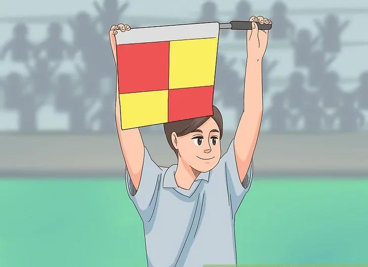 Trọng tài biên giơ cờ lên để báo hiệu có sự thay đổi người