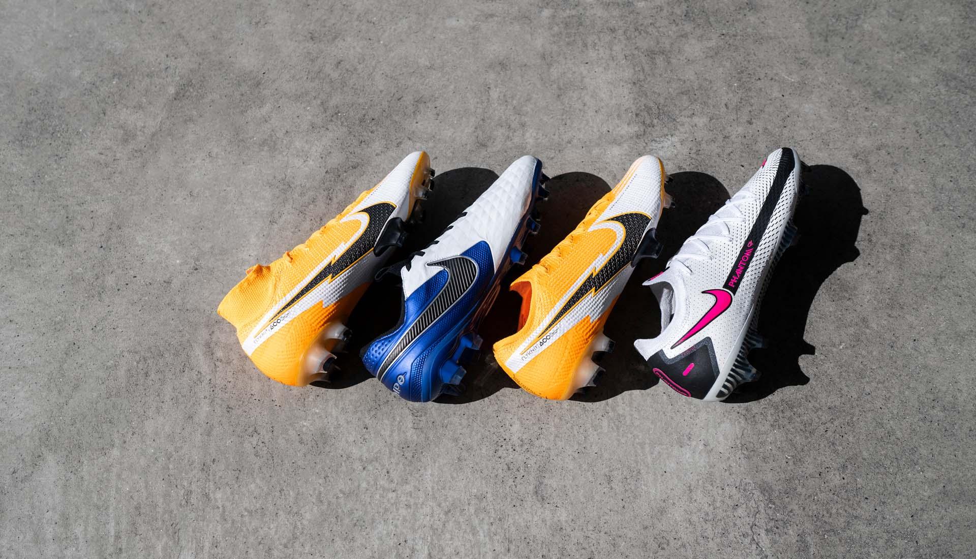 Giày bóng đá Nike Daybreak Pack với gam màu trắng vàng cam nổi bật